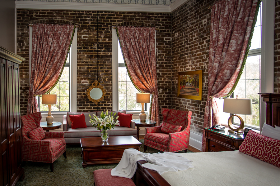 Original real brick walls in a corner suite at East Bay Inn in Savannah